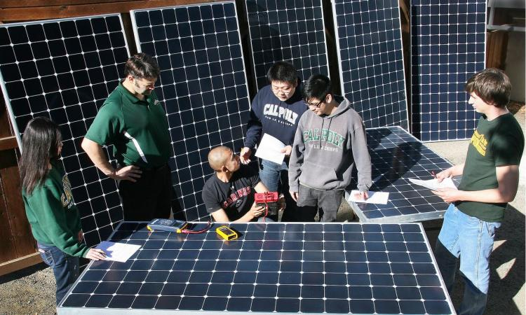 Students testing solar panels