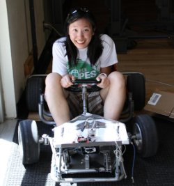 female student on race car