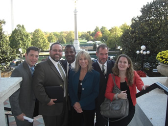 Dr. Greenwood (second from left) and Up2Us on the steps of the Old Executive Building on the White House grounds