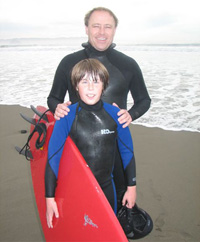 Dr. Hendricks posing with his son at the beach