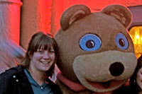 Chelsea posing with giant teddy bear