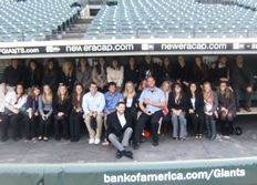 Students pose in dugout at AT&T Park