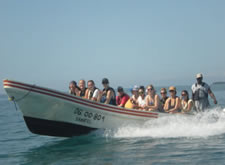 Students riding motorboat in Belize