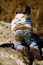 Boy playing in mud/dirt