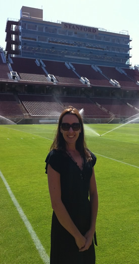Landers poses at Stanford's football stadium