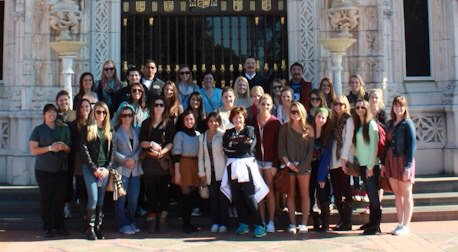 Students pose with Root and Eller on the front steps of Hearst Castle