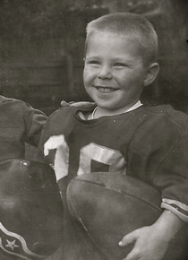 Dr. Hendricks as a young child in his football uniform