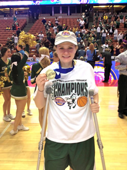 Kayla poses on the court with her NCAA medal