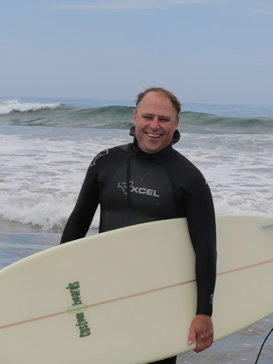 Dr. Hendricks pauses for a photo after surfing