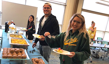 Students eating food from a buffet