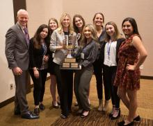 Students posing with the TAGA trophy