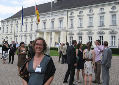 Dr. Molly Loberg stands in front of Schloss Bellevue, the official residence of the President of Germany