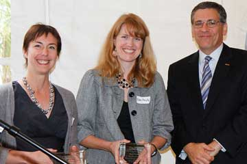 Dr. Loberg and Dr. Murphy receive award from President Armstrong