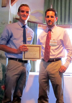 Student, Wyatt Oroke receives award from Professor Andrew Morris
