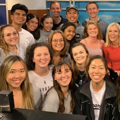 Journalism students in broadcast studio
