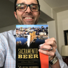 Justin Chechourka with his book Sacramento Beer