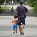 Photo of dad and son running