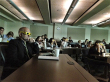 Photo of audience wearing 3D glasses