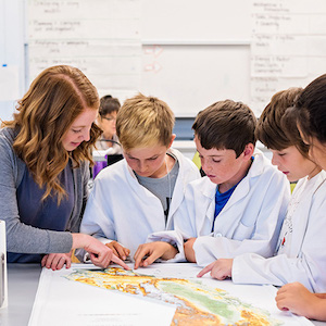 student teaching children about California map