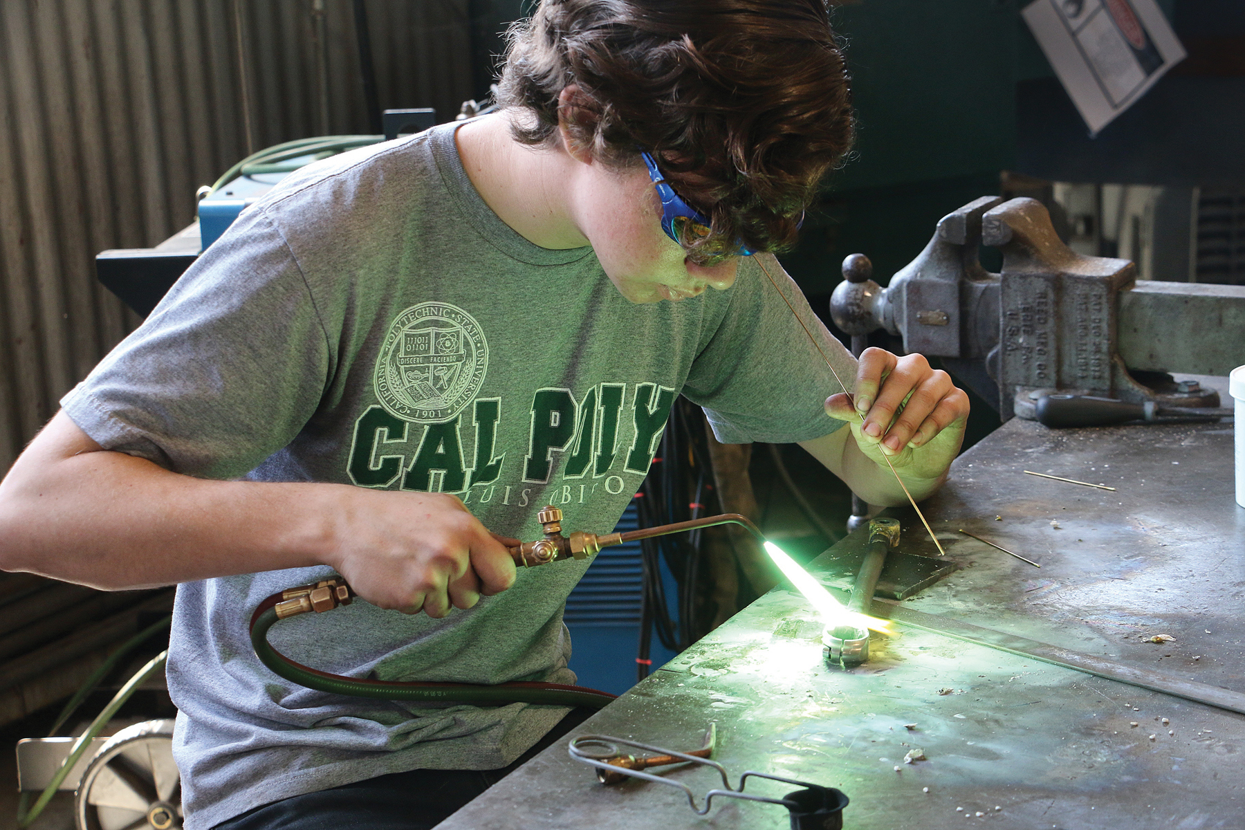 Student wearing safety glasses working in the shop