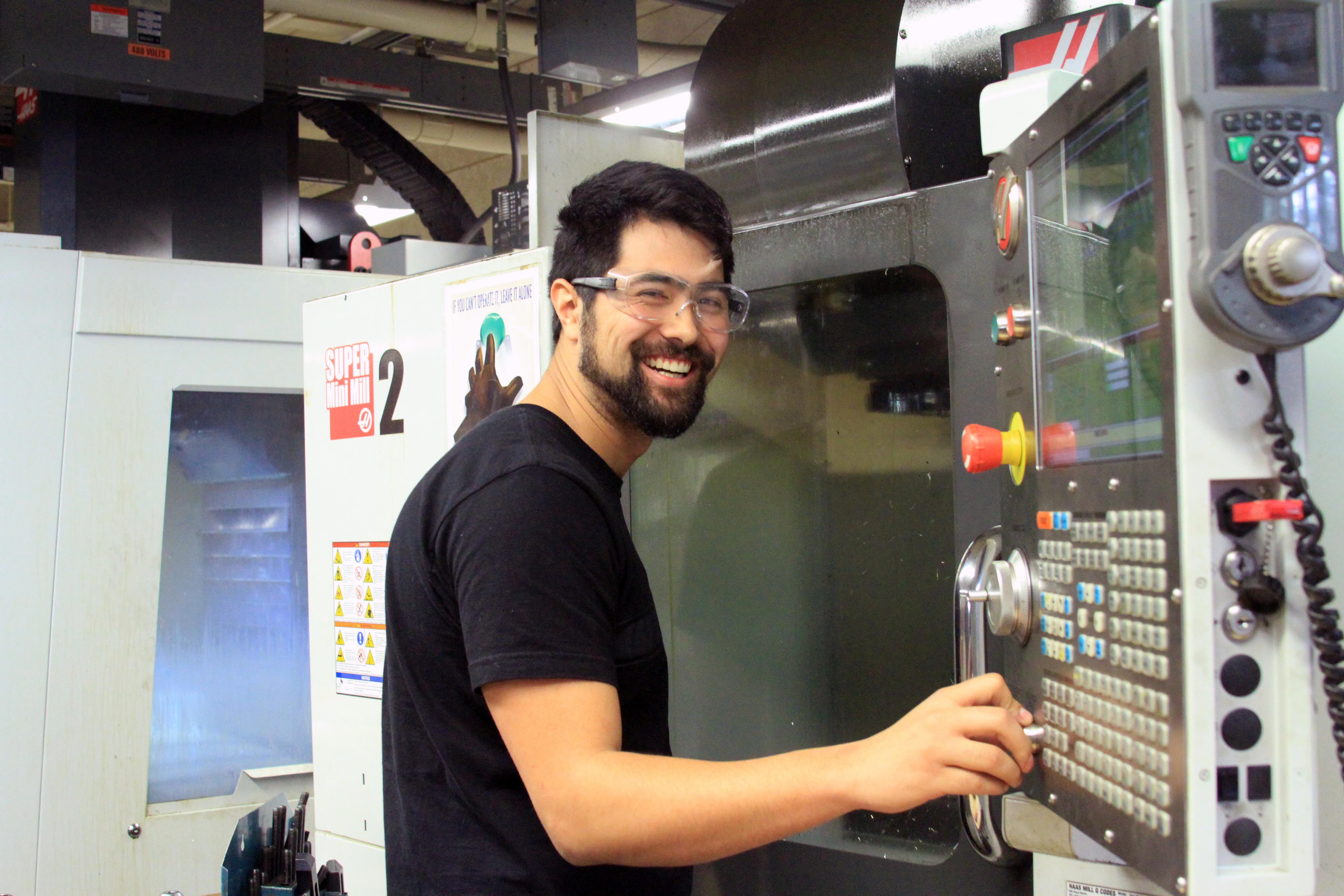 Photo of a student shop technician with safety glasses.