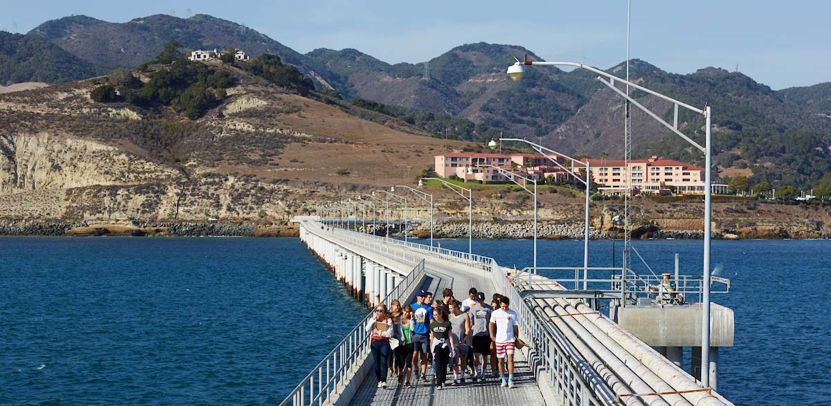 Stock image. Student walk on Cal Poly research pier.