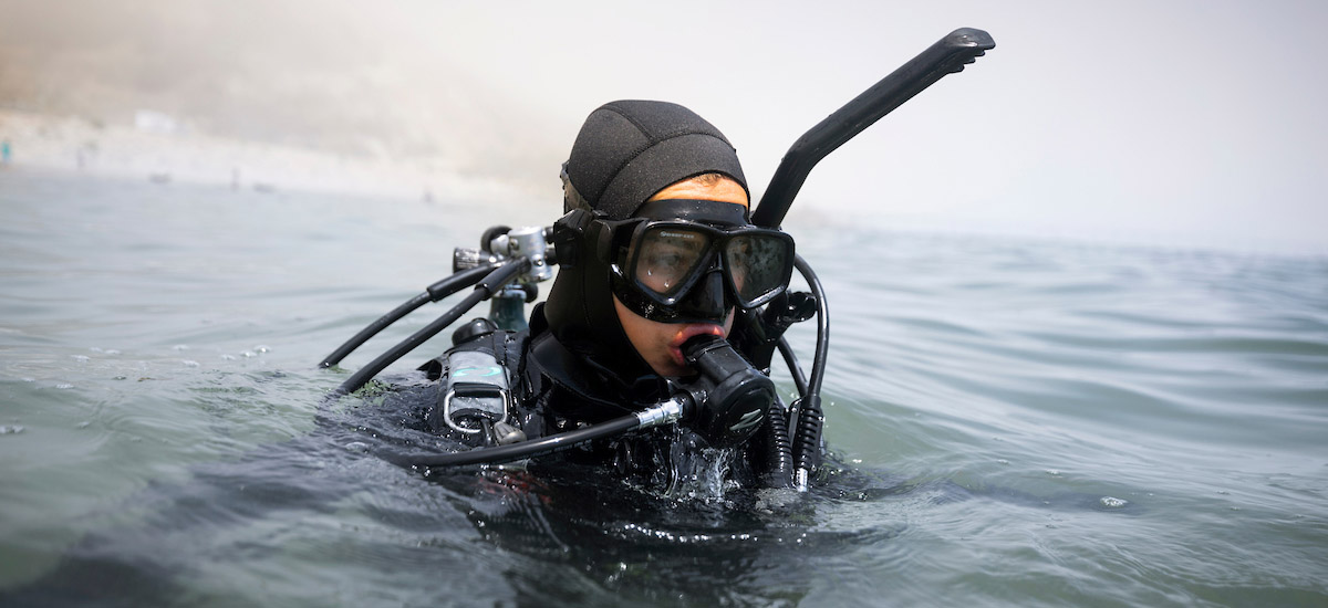 Stock image. Student in scientific diving training environment.