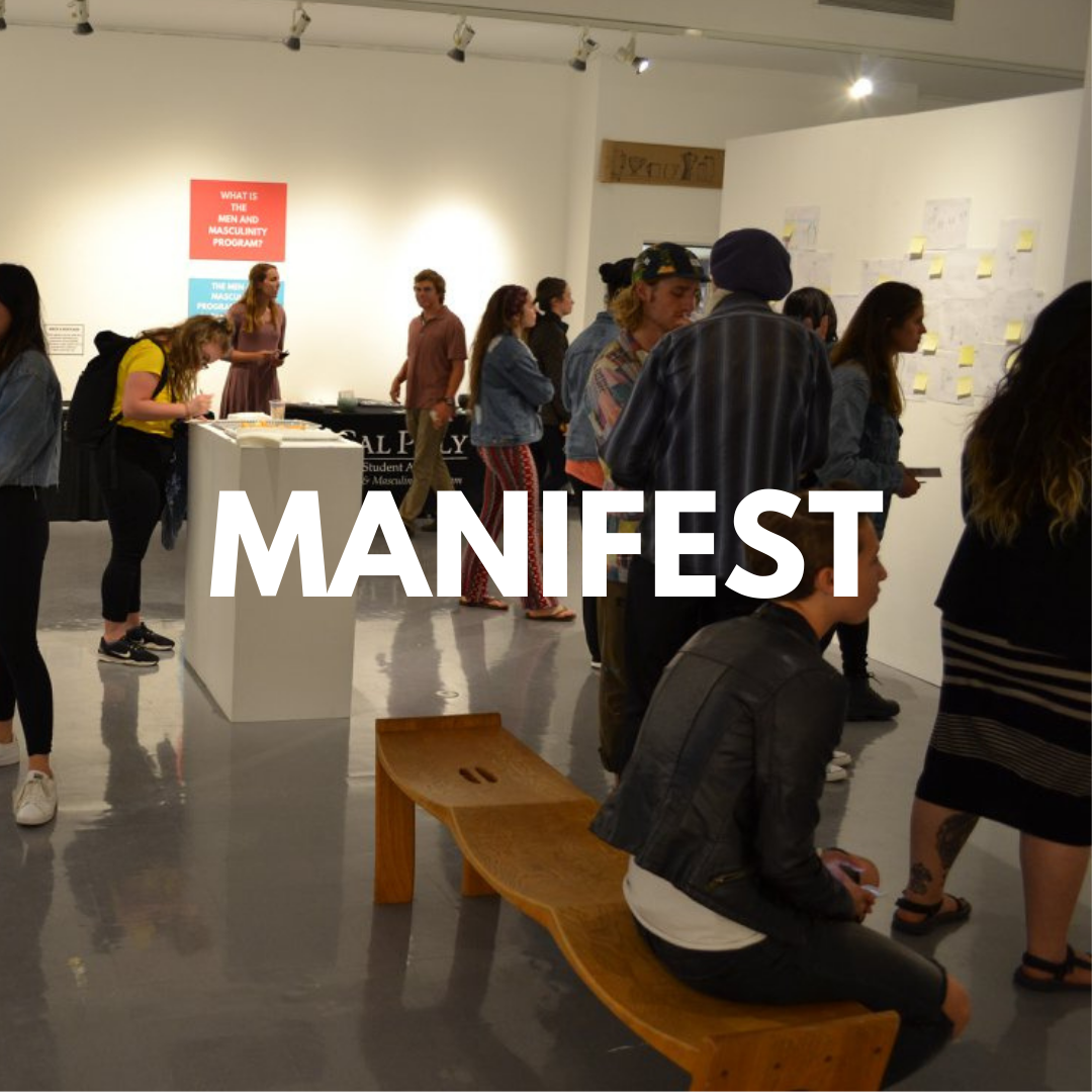 """Photo of several people walking around an art gallery, the word """"Manifest"""" is written in the center of the image."""