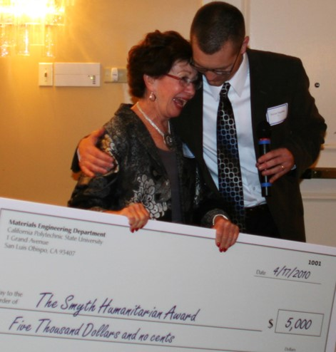 Noni Smyth receiving a surprise check to create her humanitarian service award for MATE students