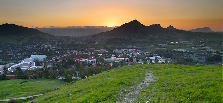 Sunset landscape view of Cal Poly campus from a nearby footpath
