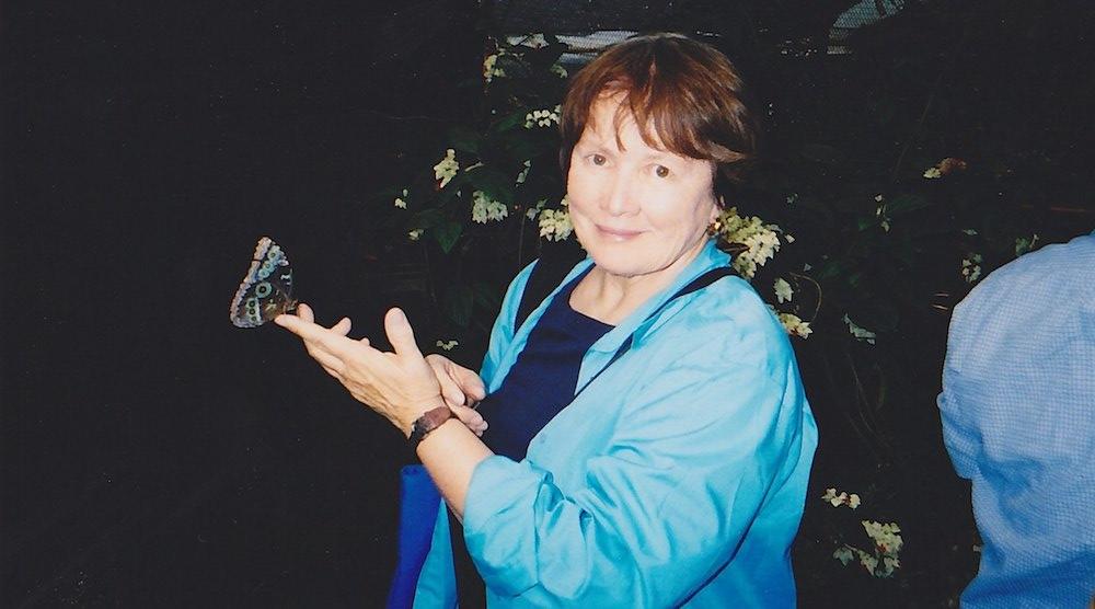 Professor Emeritus Jean Marie McDill hold a butterfly