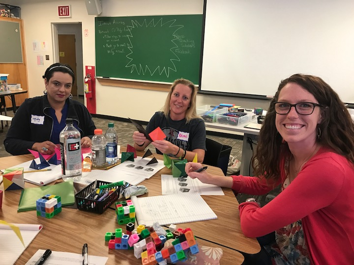 3 math teachers at a desk, working