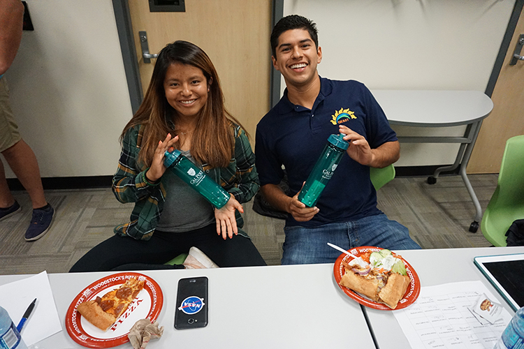 MEP students holding Cal Poly branded water bottles