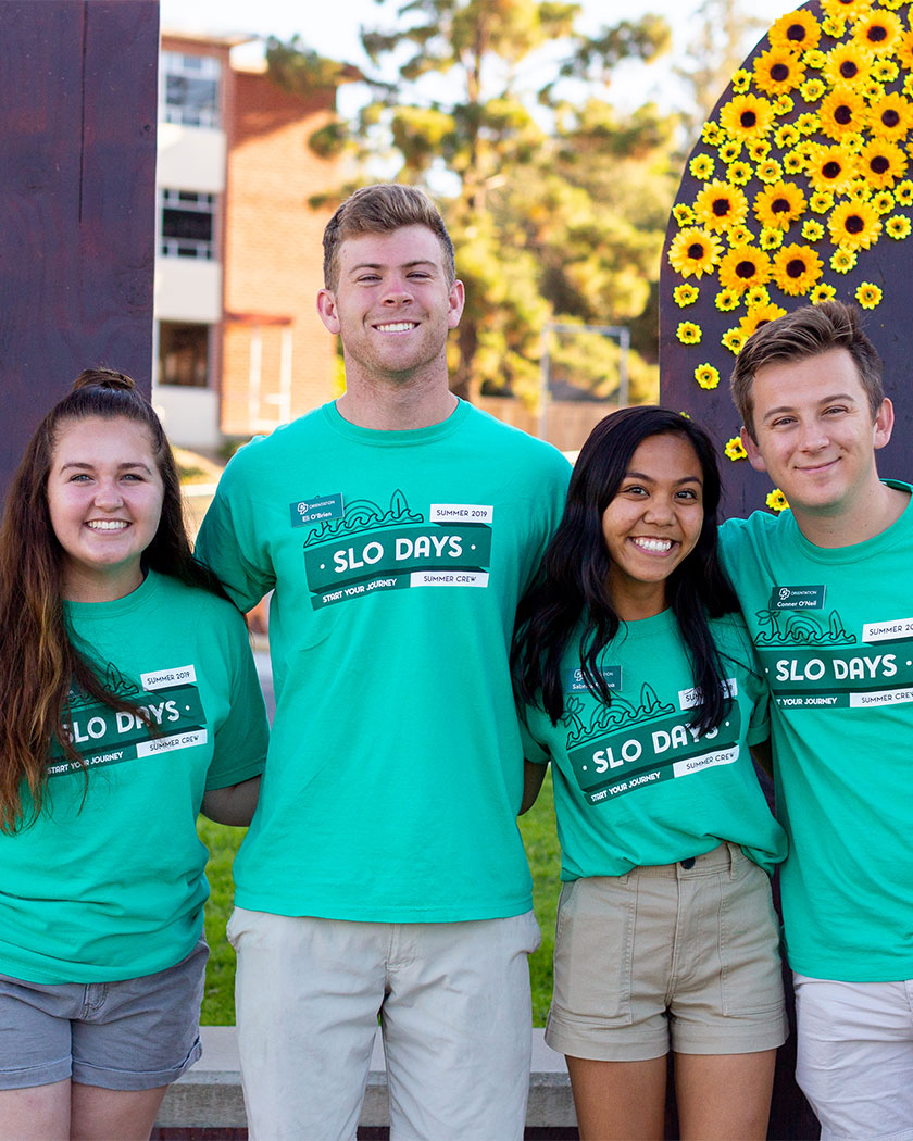 Four SLO Days Leaders help students get checked in for their Orientation session