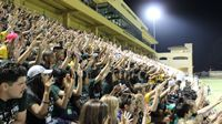 Students making a wave in the stands at Spanos Stadium