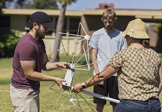 Professor and students construct radio antenna