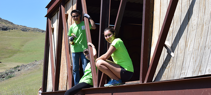 Teddy Khieu, Sarah Dowthwaite, and Dani Rustagi remove wood panels from Bridge House