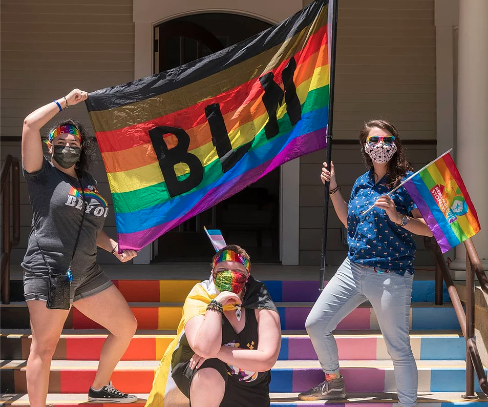 PRIDE students hold a BLM sign