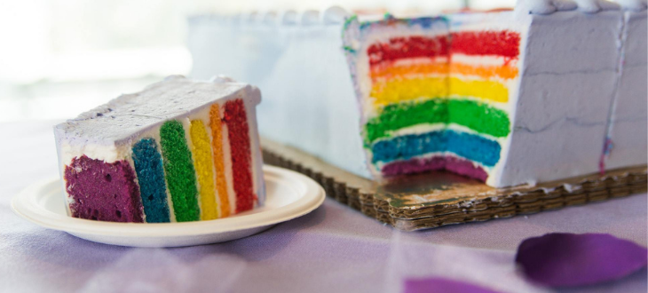 An image of a rainbow lavender commencement cake.