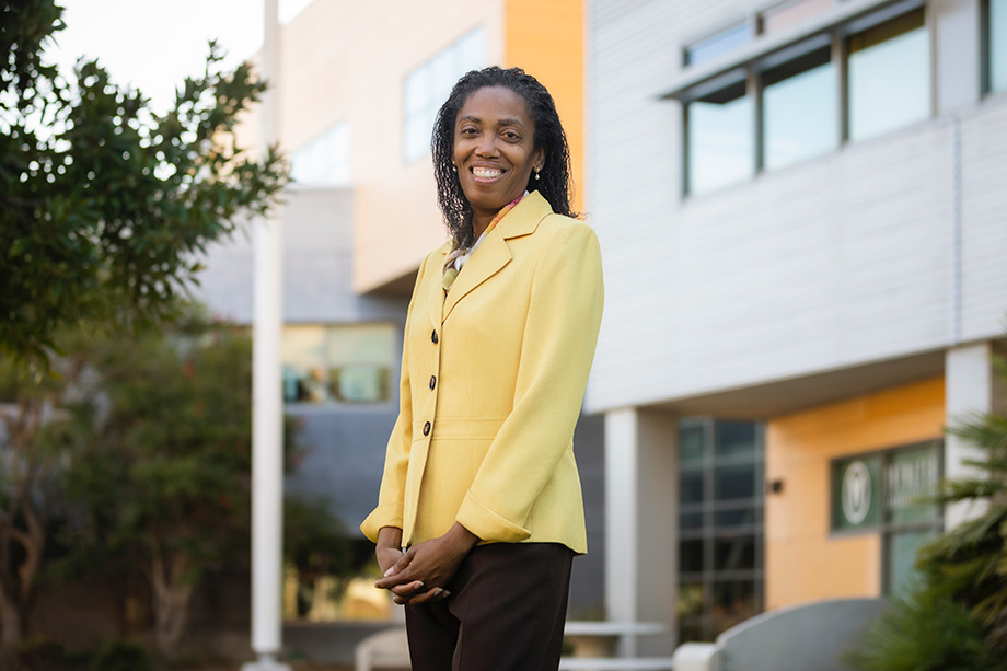 Provost Cynthia Jackson-Elmoore smiling in front of science building