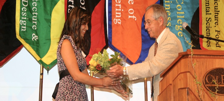 Scholarship recipient receives flowers from scholarship chair