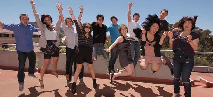 Students jumping at an event.