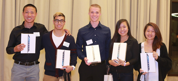 Students accepting iPad awards.