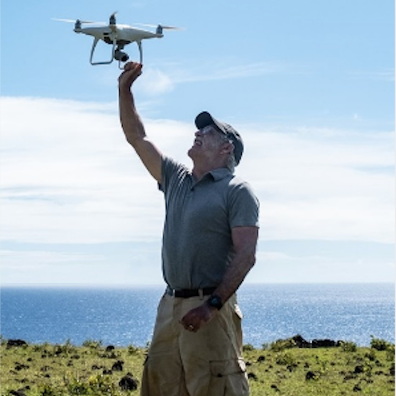 Dr. Terry Jones with his new friend, an unmanned aerial vehicle (drone), on Easter Island.