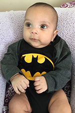 Baby in batman onesie