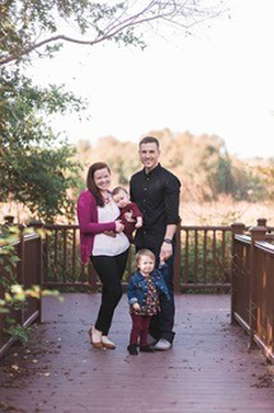 Family portrait outside with wife, husband and two kids