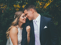 Wedding photo of wife and husband looking at each other outside