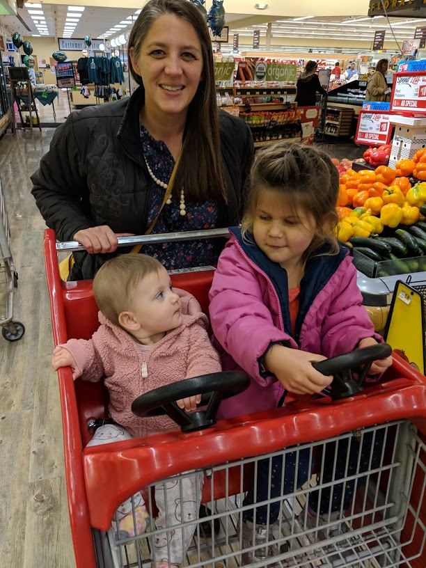 Shannon Pileggi with her two kids in a shopping cart