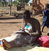 A women siting on a blanket in Malawi.