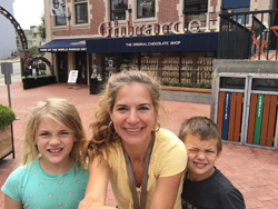 Alicia Fry Davis with her son and daughter in front of Ghirardelli store